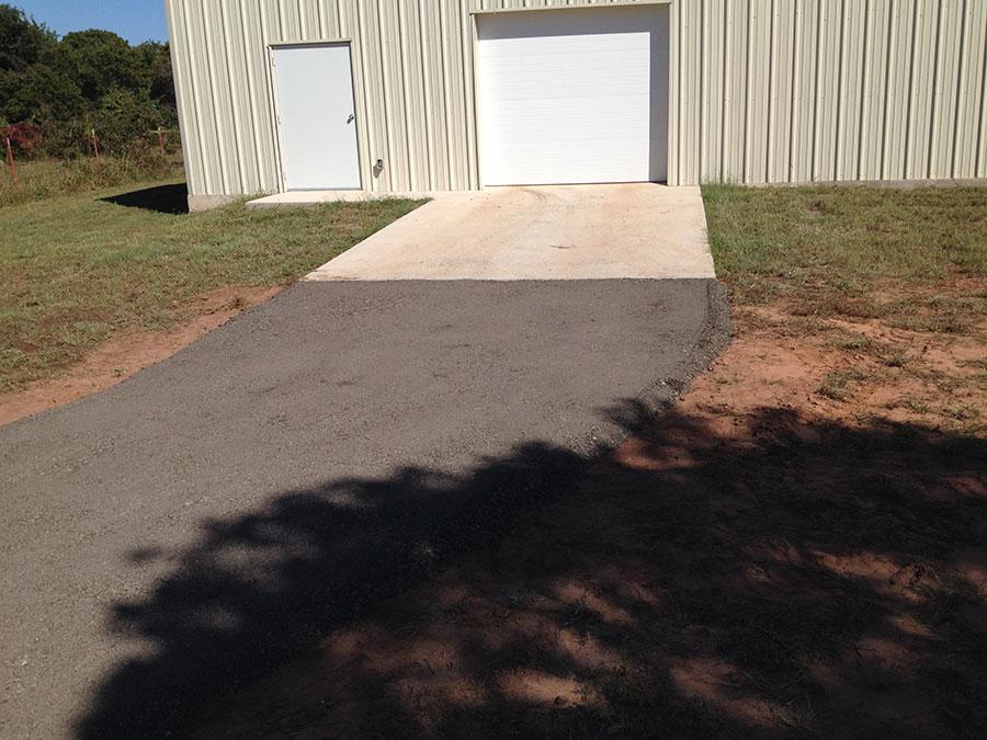 Asphalt Driveway to Metal Building